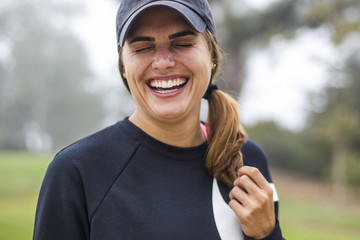 Portrait of laughing woman in sports clothing