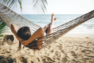 Happy woman relaxing in hammock Fotomurais