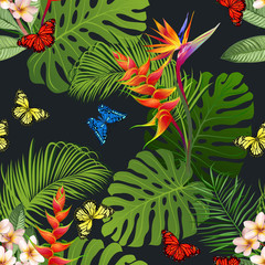 Seamless pattern with tropical flowers, butterflies, palm and monstera leaves on black background. Floral seamless texture for print design.
