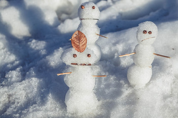 Sad snowmen. Spring came and the snow melts