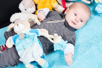Cute newborn baby lying with a toy teddy bear