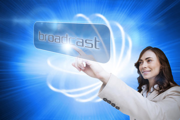 Businesswoman pointing to word broadcast against background with shiny ball