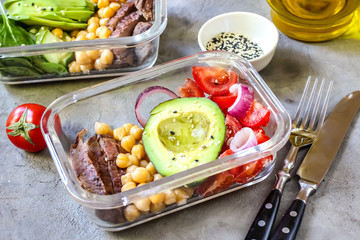 Healthy meal prep containers with chickpeas, goose meat