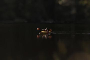Carefree boy kayaking in lake