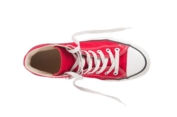 Wall Mural - Red sneaker close up on white background