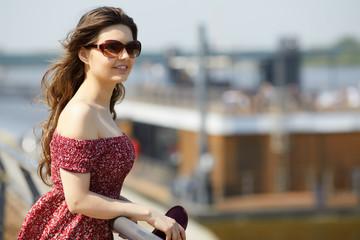 Bright lifestyle fashion portrait of sensual beautiful young woman