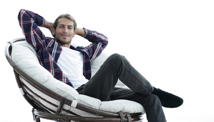 close-up. a successful guy sitting in a large round comfortable chair