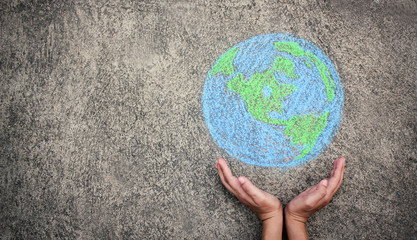 Closeup hands holding earth draw with chalk. World harmony green peace environment earth day together concept banner.