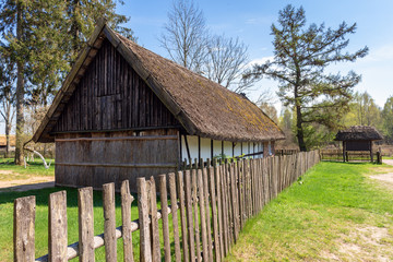 Wooden fence and old house