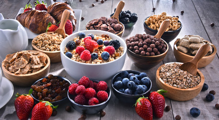 Different sorts of breakfast cereal products and fresh fruits