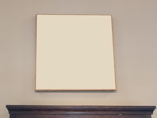 Blank Beige Picture Frame on a Wall