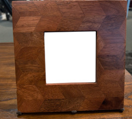 Blank White Picture Frame with Thick Wood Border on a Table