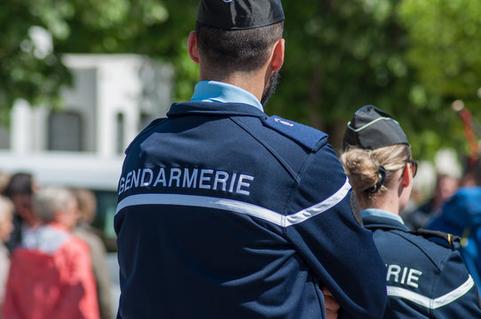 Brisach - France - 1 May 2018 - french gendarmerie patrol in lily of the valley party in the street