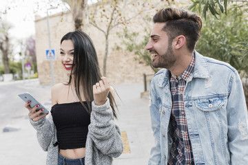 Man sends a compliment to a woman and make her nervous with complicity