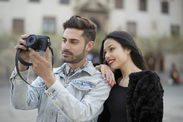 Young couple taking photography in the city