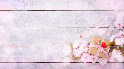 Romantic light wooden background with gift box, flowers and heart  -  Panorama, Banner