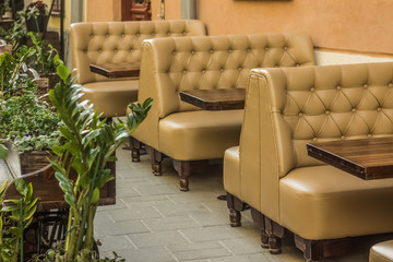cafe outdoor space patio with table and  soft armchairs