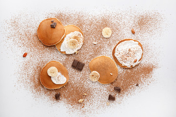Flat lay composition with tasty pancakes on light background