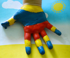 Children's hand in the paint.Baby's drawing, creativity, learning, development