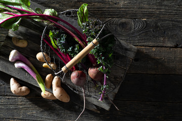 Fresh Raw Vegetables on a Rustic Farmhouse Table