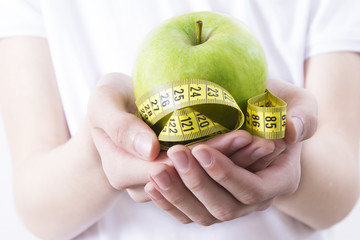 diet, beauty and healthy life, hand with tape measure and apple