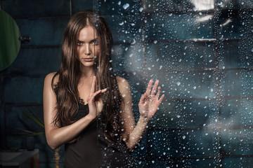 Attractive brunette girl over water drops.