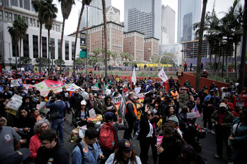 People march in a May Day rally in Los Angeles