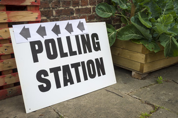 British election polling station sign propped up in an urban market in the UK