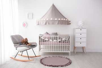 Interior of baby room with comfortable crib