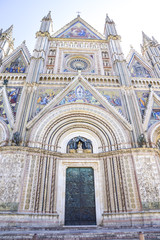Facade of the Cathedral of Orvieto (Duomo di Orvieto) Italy. Construction in Gothic style dedicated to the Virgin Mary