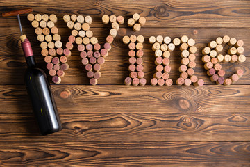 Wine lettering arranged of corks with bottle