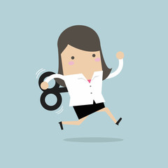 Businesswoman running with wind-up key.