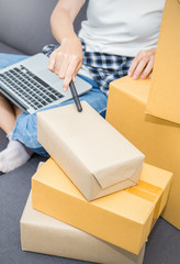 Startup small business entrepreneur SME or freelance woman working with box at home, online marketing packaging box and delivery, SME e-commerce concept