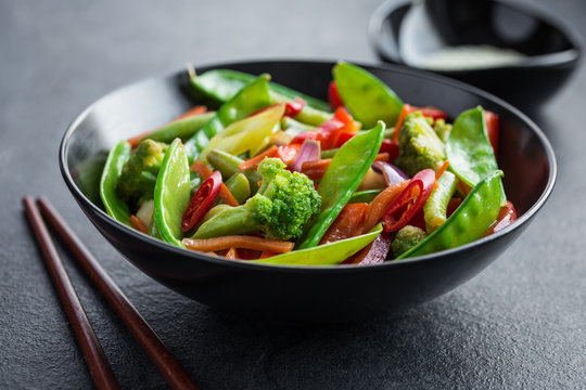 stir fry vegetables in black bowl
