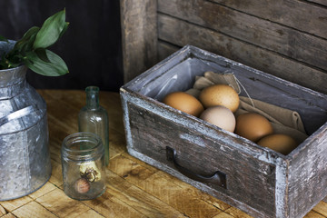 Brown chicken eggs in old wooden box, home farm