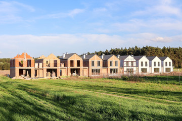 a row of houses under construction in different stages of development