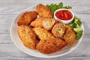 meat croquettes on a white plate