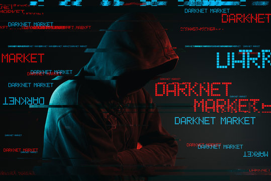 Darknet market concept with faceless hooded male person