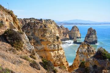 Elevated view of the rugged coastline and cliffs at Ponta da Piedade, Lagos, Portugal.