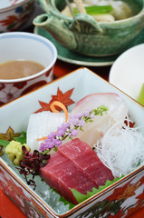 Japanese traditional food sashimi with squid, tuna and snapper served with shredded radish
