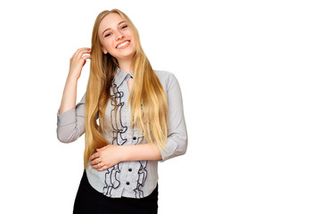 Beautiful woman with makeup and long blonde hair blows kiss, demonstrates her good feelings, says goodbye on distance, isolated over white background. Young pretty female model smiling.