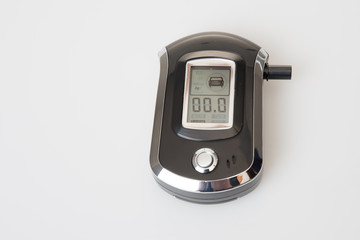 Breath analyzer for measuring blood alcohol content Don't drink and drive concept with breathalyzer