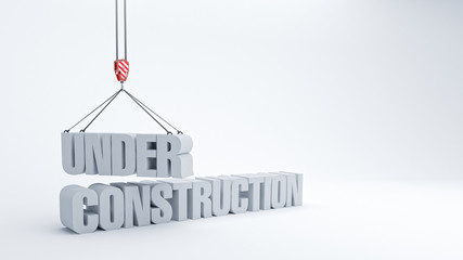Under construction sign and crane hook  on white background