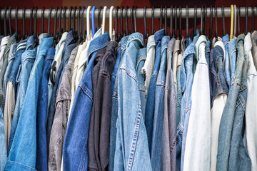 Rack of denim jackets on display at Camden market in London