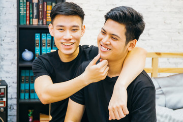 Asian gay couple spending time together at home. Portrait of happy gay men - Homosexual love concept