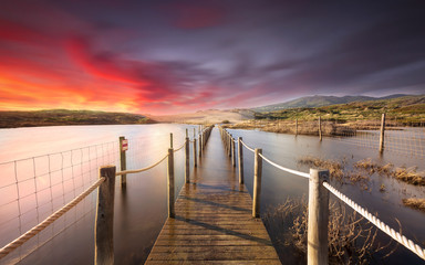 Warm sunset on the flooding pier