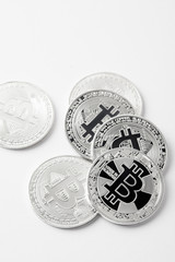 top view of pile of bitcoins on white surface