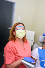A patient getting treatment in a dental studio