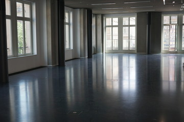 Big abandoned and empty room interior full of glass windows