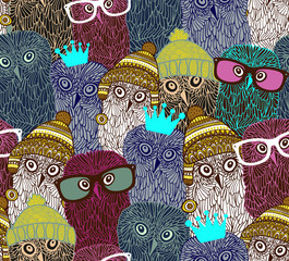 Wonderful owls in seamless pattern.